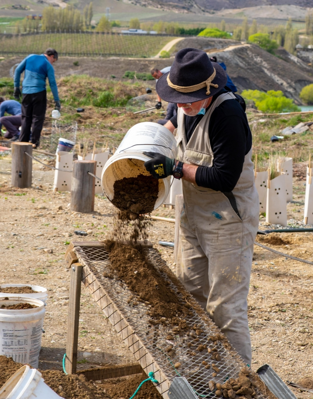 Sifting_dirt_community_planting_native_trees_restoration