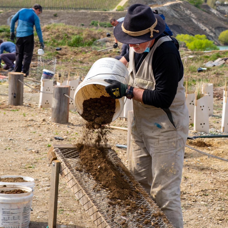 Sifting_dirt_community_planting_native_trees_restoration